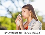 beautiful woman using tissue... | Shutterstock . vector #573840115