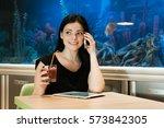 stylish brunette woman sitting...   Shutterstock . vector #573842305