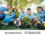 Small photo of Portrait of volunteer group planting in park