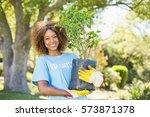 portrait of volunteer woman... | Shutterstock . vector #573871378