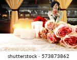 wooden desk and woman on sofa    Shutterstock . vector #573873862