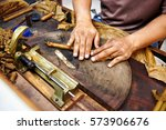 closeup of hands making cigar...   Shutterstock . vector #573906676
