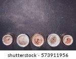 beer glasses on dark table | Shutterstock . vector #573911956