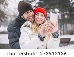 happy couple taking selfie by... | Shutterstock . vector #573912136