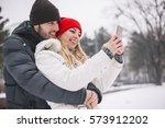 happy couple taking selfie by... | Shutterstock . vector #573912202