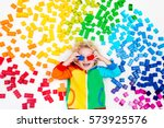 funny little boy playing with... | Shutterstock . vector #573925576
