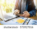 business man working at office... | Shutterstock . vector #573927016