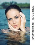 Wet head of the beautiful woman in the summer water. Artistic colors added - stock photo