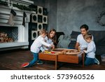 happy family playing with toy... | Shutterstock . vector #573960526