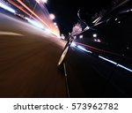 fast back car on the night city ... | Shutterstock . vector #573962782