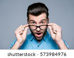 wow  surprised young man with... | Shutterstock . vector #573984976