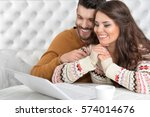 young smiling couple | Shutterstock . vector #574014676
