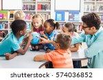 teacher and kids discussing... | Shutterstock . vector #574036852