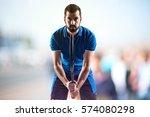 tennis player on unfocused... | Shutterstock . vector #574080298