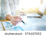 working business people analyse ... | Shutterstock . vector #574107052