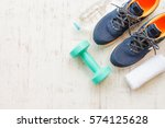 blue running shoes with fitness ...   Shutterstock . vector #574125628