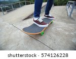 young skateboarder legs riding... | Shutterstock . vector #574126228