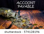 "Small photo of Coins in glass jar for money saving financial and business concept with wording ""ACCOUNT PAYABLE"""