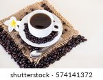 a cup of coffee with a spoon ... | Shutterstock . vector #574141372