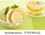 a cup of tea with citrus fruits | Shutterstock . vector #574149142