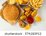 junk food on white table. fast... | Shutterstock . vector #574183912