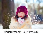 Little Girl Blowing Snow From...