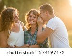 boy whispering his sibling's... | Shutterstock . vector #574197172