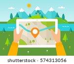 hiker reading digital map on...