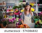 portrait of smiling florist... | Shutterstock . vector #574386832