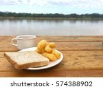 breakfast on the wooden table... | Shutterstock . vector #574388902