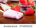homemade strawberry ice lolly... | Shutterstock . vector #574390102