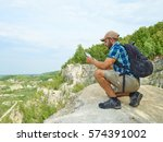 man tourist uses tablet... | Shutterstock . vector #574391002