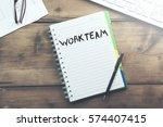 work team text on notebook... | Shutterstock . vector #574407415