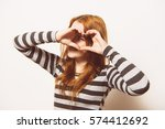 woman making a hand heart frame | Shutterstock . vector #574412692