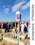Small photo of MECCA, SAUDI ARABIA - FEB 8: Muslims at Mount Arafat (or Jabal Rahmah) February 8, 2017 in Arafat, Saudi Arabia. This is the place where Adam and Eve met after being overthrown from heaven.