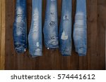 Five Blue Jeans On Wooden...
