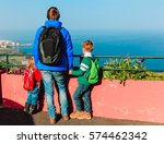 father with two kids travel in... | Shutterstock . vector #574462342