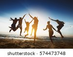 group of happy friends runs and ... | Shutterstock . vector #574473748