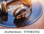 vinyl record and headphone over ... | Shutterstock . vector #574481542