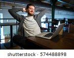 man using laptop in restaurant | Shutterstock . vector #574488898