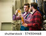Small photo of Brewers testing beer at brewery factory