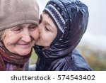 grandson kisses his grandmother.... | Shutterstock . vector #574543402