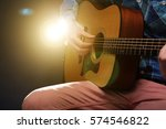 man playing on acoustic guitar...   Shutterstock . vector #574546822
