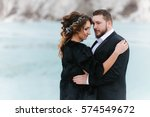 beautiful wedding couple on a... | Shutterstock . vector #574549672