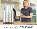 woman controlling smart kettle...   Shutterstock . vector #574556446