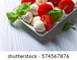 mozzarella with tomato and... | Shutterstock . vector #574567876