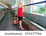 happy little child with luggage ... | Shutterstock . vector #574577746