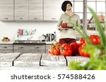 tomatoes on wooden table and... | Shutterstock . vector #574588426