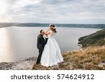 couple with a bouquet and... | Shutterstock . vector #574624912