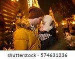 winter walk of happy couple | Shutterstock . vector #574631236